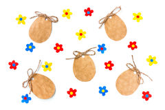 Easter egg shape paper tag with rope, applique colorful flowers. On a white background Royalty Free Stock Photography