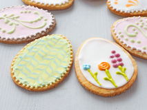 Easter egg shaped sugar cookies. Gingerbread glazed with royal icing. Food background. Royalty Free Stock Image
