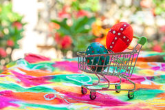 Easter egg in shopping cart on paper Royalty Free Stock Photography