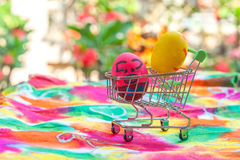 Easter egg in shopping cart on paper Stock Images