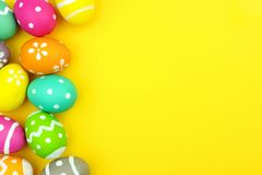 Easter egg side border over yellow paper background Stock Photos