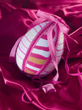 Easter egg at silk Stock Photography