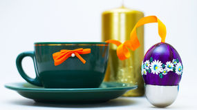 Easter Egg On Silver. Easter Egg With Coffee mug And Candle Stock Images