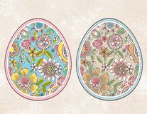 Easter egg with spring flowers and leafs over beige grunge background. Easter holidays design. Two different color. Can be used for greetings cards, print stock illustration