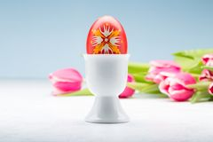 Easter egg on a stand. Typical easter egg from Slovakia with egg holder and tulips eggs background colorful white handmade decoration holiday paint symbol royalty free stock image