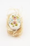 Easter egg on straw. Handmade colorful easter egg on straw nest Stock Photos