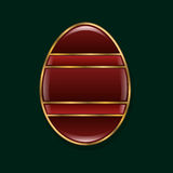 Easter egg. stylized gold and red stone.isolated object. Dark green background,  illustrations. Royalty Free Stock Photography