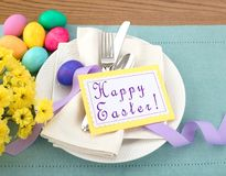 Easter Egg Table Setting with Menu or Invite Card with room or space for your words, text, copy, A horizontal flat layout. With plate, silverware, flowers, and Stock Images
