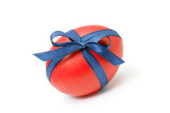 Easter egg tied in a bow isolated on white Royalty Free Stock Images
