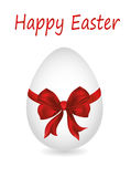Easter egg tied with ribbon and bow. Empty place for text or ad Stock Photos