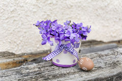 Easter egg  and vase with purple  violets Royalty Free Stock Images