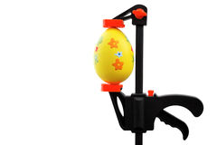 Easter egg and vise grip Royalty Free Stock Images