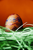 Easter egg in warm color Stock Photos