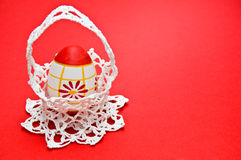 Easter egg in white crochet basket Stock Image