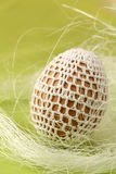 Easter egg with white crochet decoration Royalty Free Stock Photos