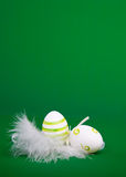 Easter egg in white feathers nest Stock Photos