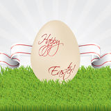 Easter egg with ribbon in grass Royalty Free Stock Photo