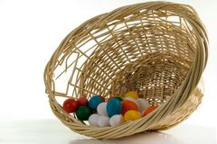 Easter Egg Wicker. Easter Basket with Real & Toy Colored Eggs Stock Photos