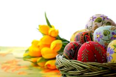 Easter egg in wicker basket Stock Images