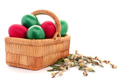 Easter egg in wicker basket Royalty Free Stock Images