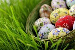 Easter egg in wicker basket Royalty Free Stock Photos