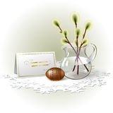 Easter egg and willow. Easter egg with beautiful brown geometric ornament, sprigs of willow in glass pitcher and congratulation card where you can write  your Royalty Free Stock Photography