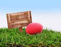 Easter egg and wood frame. Happy easter with red egg and wood frame Stock Photo