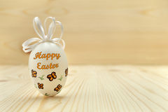 Easter egg on wooden background with free text space. Royalty Free Stock Images