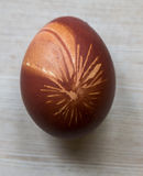 Easter egg on wooden background. Easter red egg with amazing picture on wooden background Stock Images