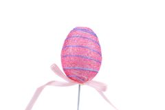Easter egg on wooden stick. Royalty Free Stock Photos