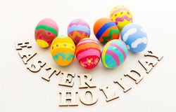 Easter egg and wooden text Royalty Free Stock Photography