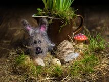 Easter egg wrapped in a jute twine and an Easter Bunny made from felt royalty free stock image