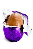 Easter egg in wrapping. Milk chocolate Easter egg with foil wrapping royalty free stock image