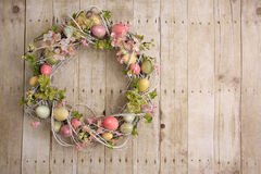 Easter egg wreath. On a wooden background. Also available in vertical Royalty Free Stock Photo