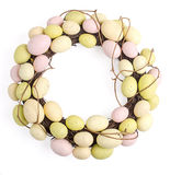 Easter Egg Wreath. Easter wreath of dried branches and painted eggs, on a white background royalty free stock images