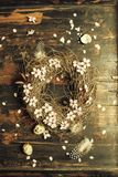 Easter egg wreath. On a wooden background stock photos