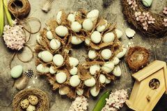 Easter egg wreath. On a grey stone background royalty free stock image
