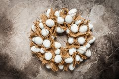 Easter egg wreath. On a grey stone background royalty free stock photo
