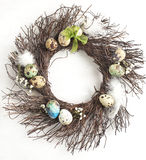 Easter egg wreath on a white wooden background. Selective focus stock image