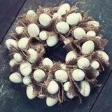 Easter egg wreath. On a wooden background royalty free stock photography