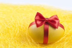 Easter egg on the yellow straw Stock Photography