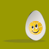 Easter egg with yolk. Design Easter eggs yolk with a joyful smile and place for text Royalty Free Stock Images