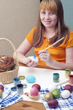 Easter eggs 1. The redhead girl hold  Easter eggs Stock Photos