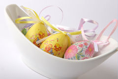 Easter Eggs. See painted easter eggs in a white dish on white background Royalty Free Stock Image