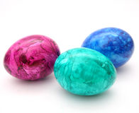 Easter Eggs. Some colourful easter eggs in blue, green and violet Royalty Free Stock Photos