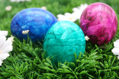 Easter Eggs. Some colourful easter eggs in blue, green and violet Stock Photography
