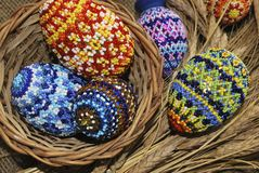 Easter eggs. From beads and basket from dry stalk Royalty Free Stock Photography