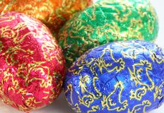 Easter Eggs. Four colored chocolate Easter eggs on white background Royalty Free Stock Photography