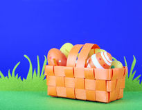 Easter eggs. Orange basket with some easter eggs royalty free stock photos