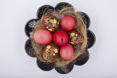 Easter Eggs. Bowl with Easter red eggs and ladybirds beetles Stock Image